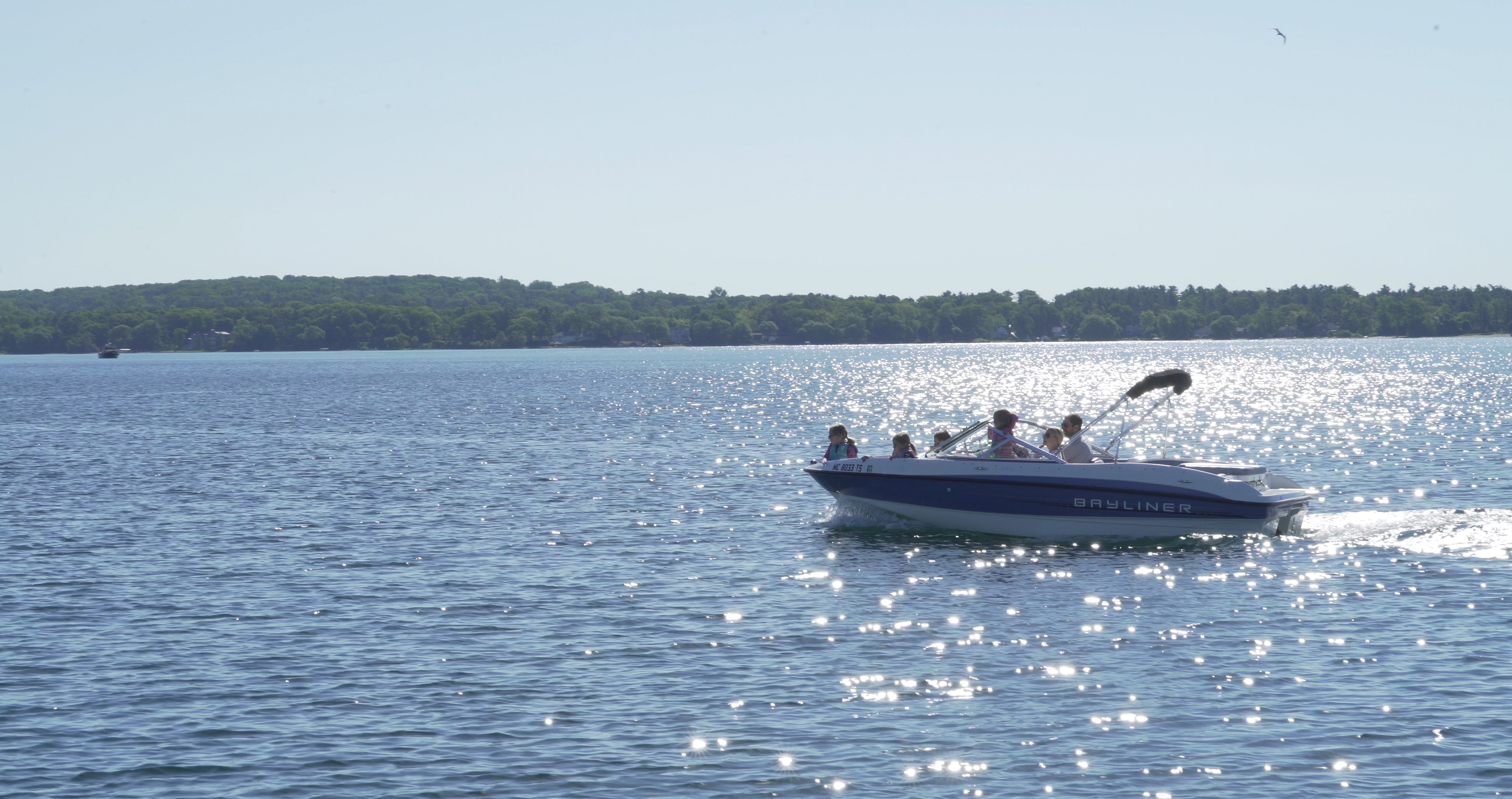 Family cruising in a speedboat