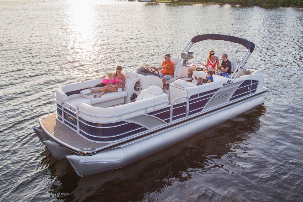Family enjoying a ride on a Aqua Patio 25', 16 person, 225 horse powered Pontoon Boat