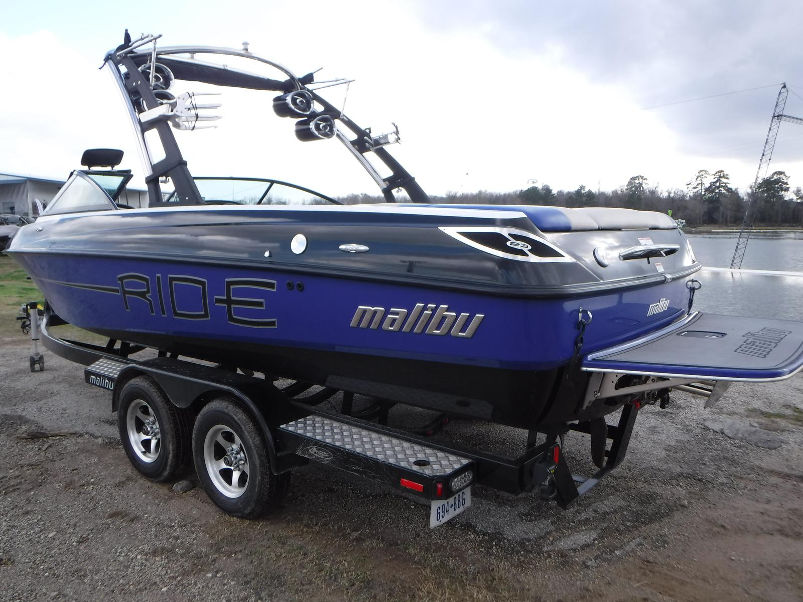 Side view of a Malibu Wakesetter on a trailer