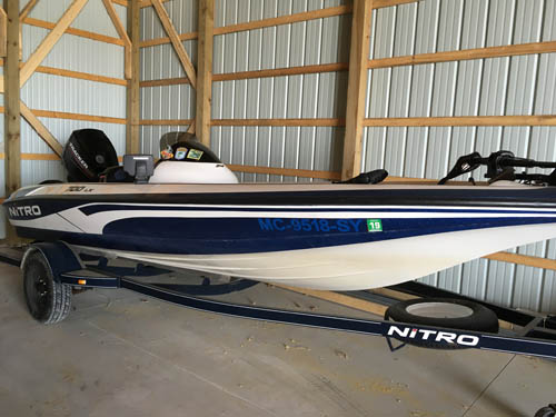 Side view of Nitro 700 LX Fishing Boat on trailer