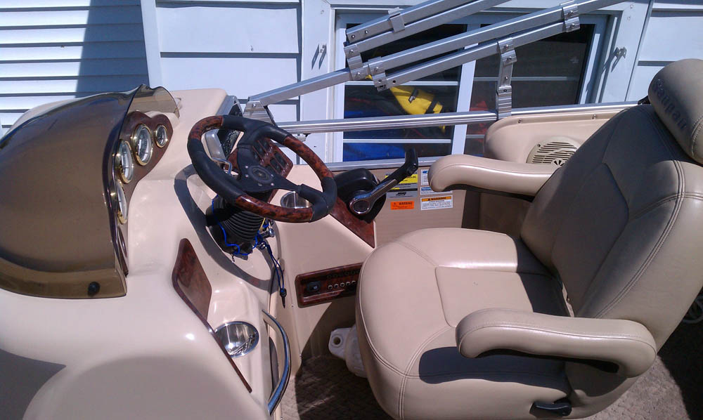 Close up view of the captain's seat on a Sanpan Pontoon Boat