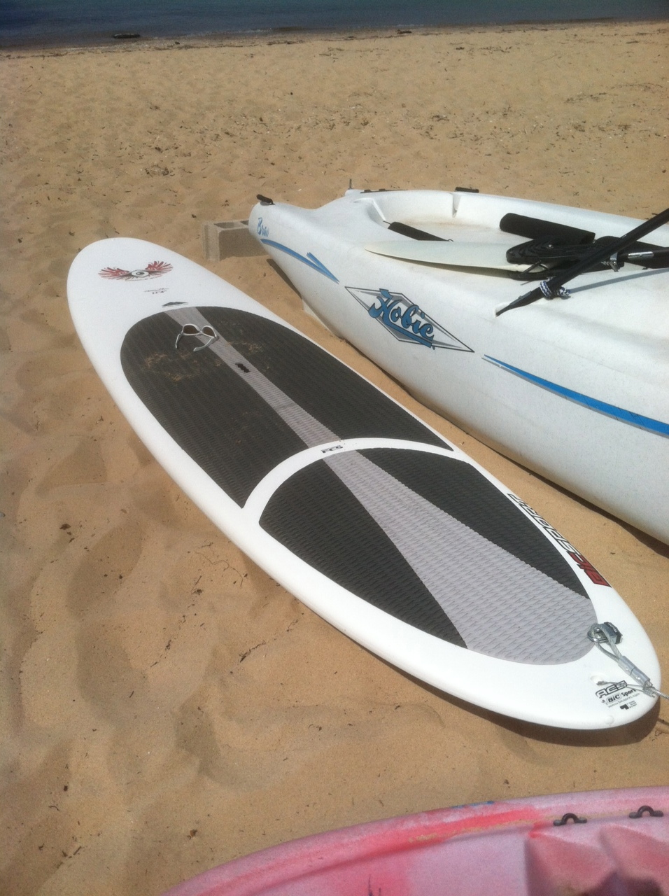 Stand Up Paddle Board in the sand on the beach